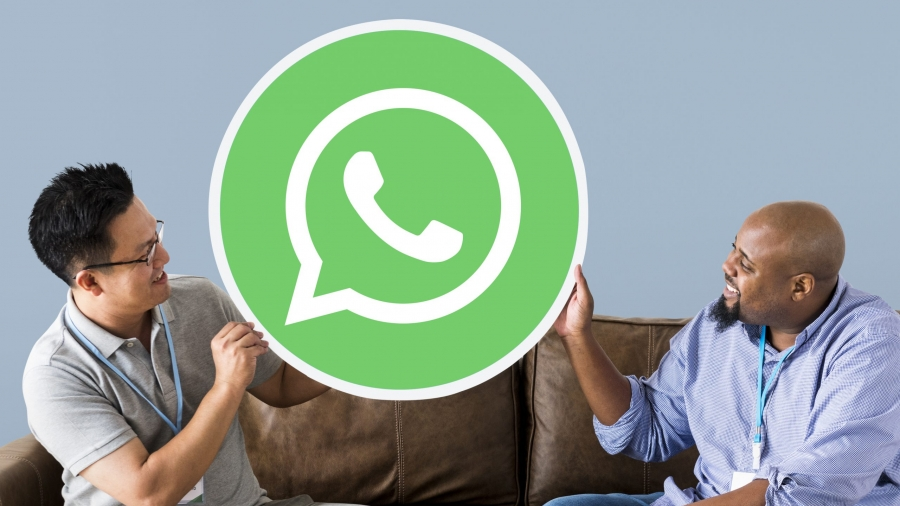 Men showing a WhatsApp Messenger icon